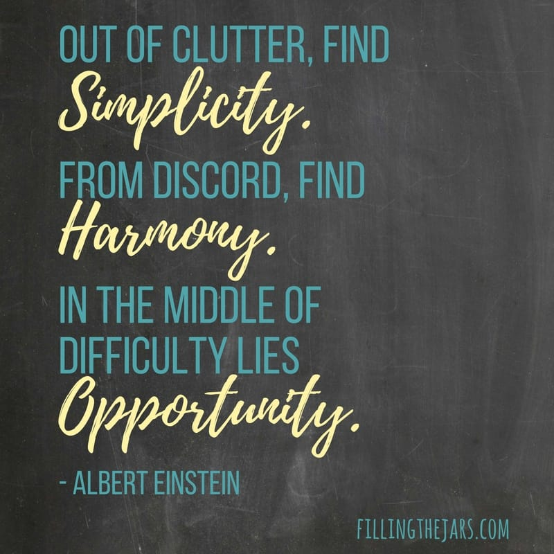 Albert Einstein quote in the middle of difficulty lies opportunity in yellow and teal text on chalkboard background