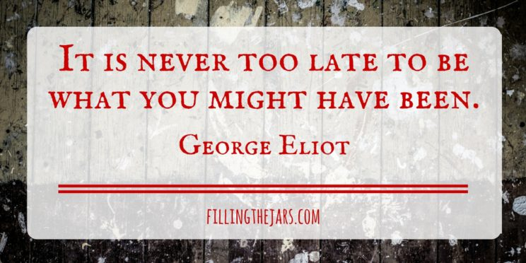 George Eliot quote it is never too late in red text on white background over image of paint-stained wood floor