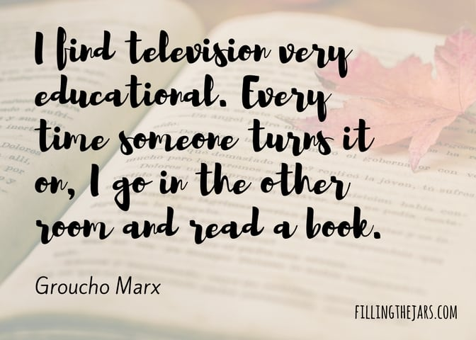 Groucho Marx quote I find television very educational on transparent white background over image of open book and red maple leaf