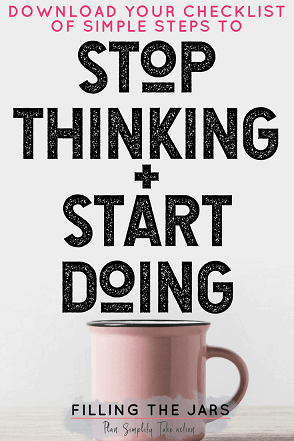 pink mug on grey background with text download checklist to start setting and reaching goals