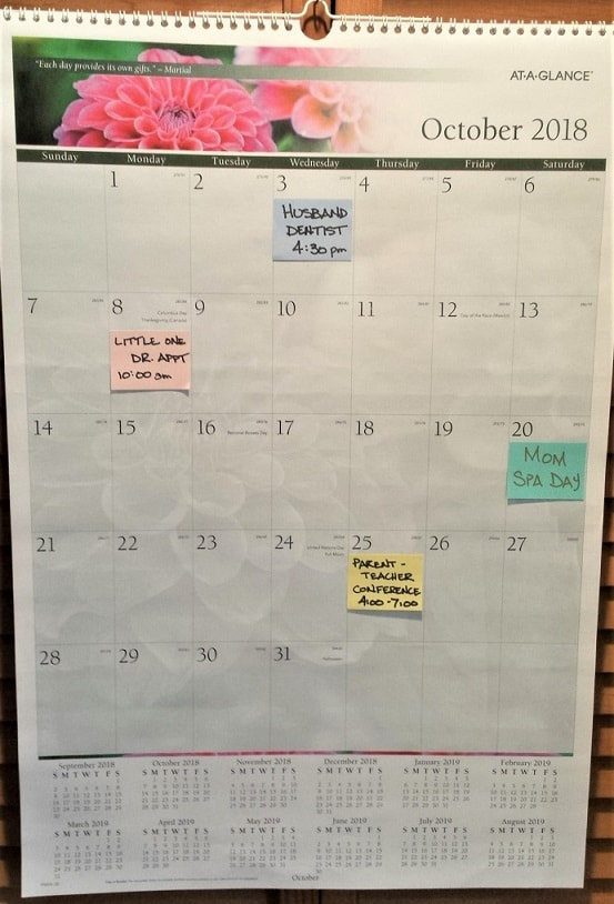 calendar with large spaces for sticky notes - located next to refrigerator command center