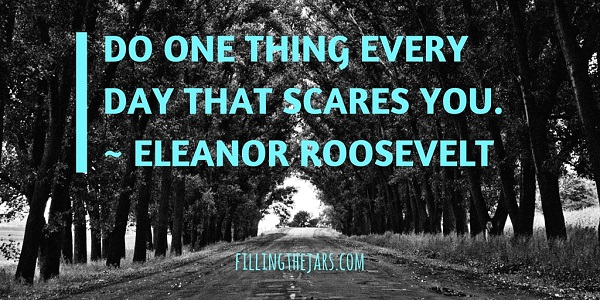 Eleanor Roosevelt motivational quote turquoise text over black and white image of road through trees
