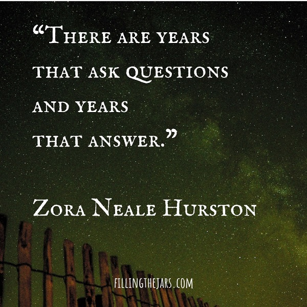 Zora Neale Hurston inspirational quote text on image of green-tinted night sky and wood fence pickets
