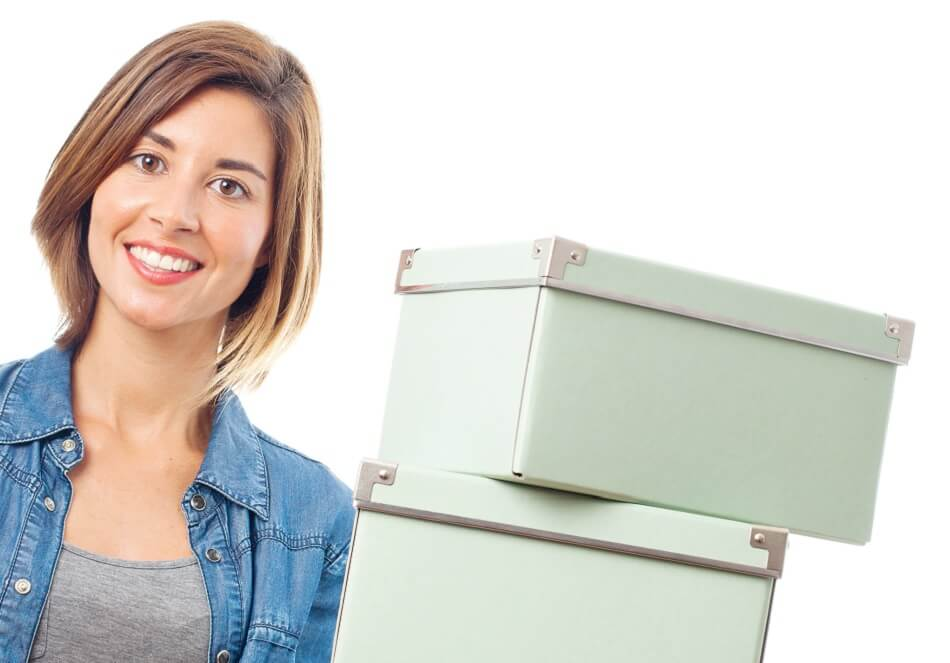 smiling woman holding decorative white boxes for clutter storage