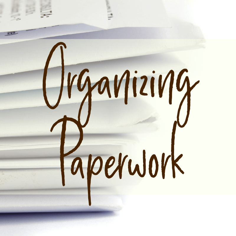 papers and receipts in white files with text overlay organizing paperwork