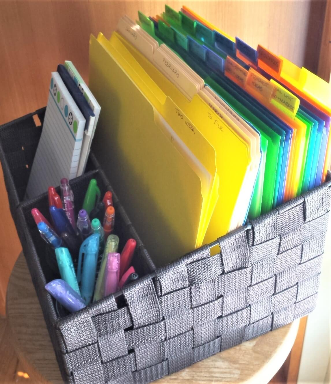 woven file basket with organized files pens and notepads