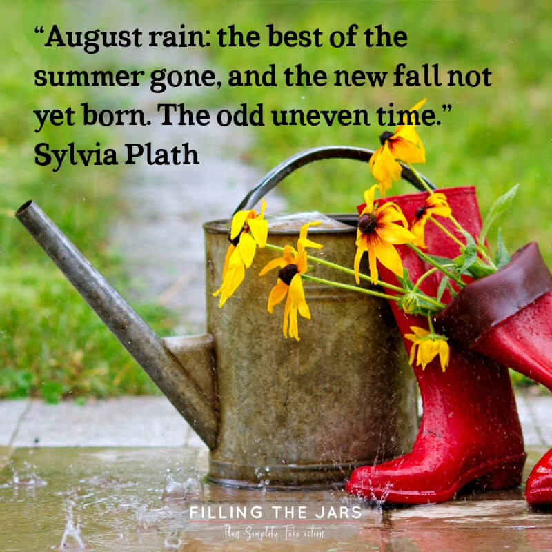 watering can and red boots on sidewalk during summer rain with text overlay quote sylvia plath august rain odd uneven time