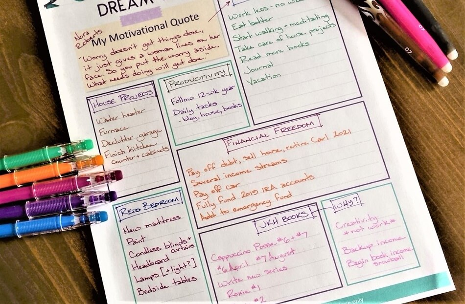 dreams and goals worksheet on table with colored pens for planning