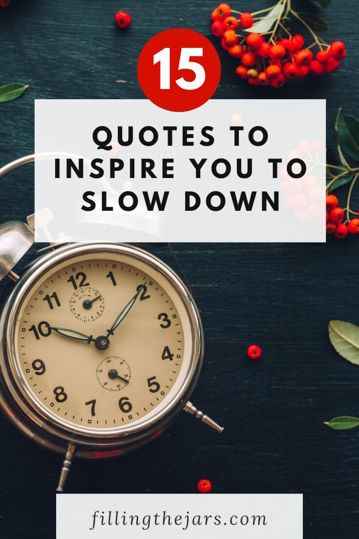 clock and red berries on dark background with white overlay and text 15 quotes to inspire you to slow down
