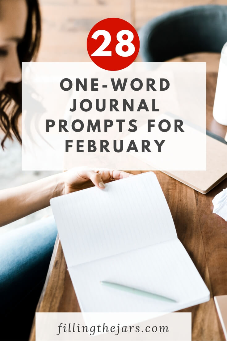woman sitting at wooden table with open notebook getting ready to use February journal prompts