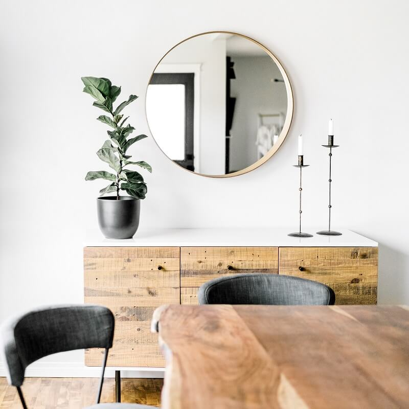 white dining room with minimalist decor after decluttering