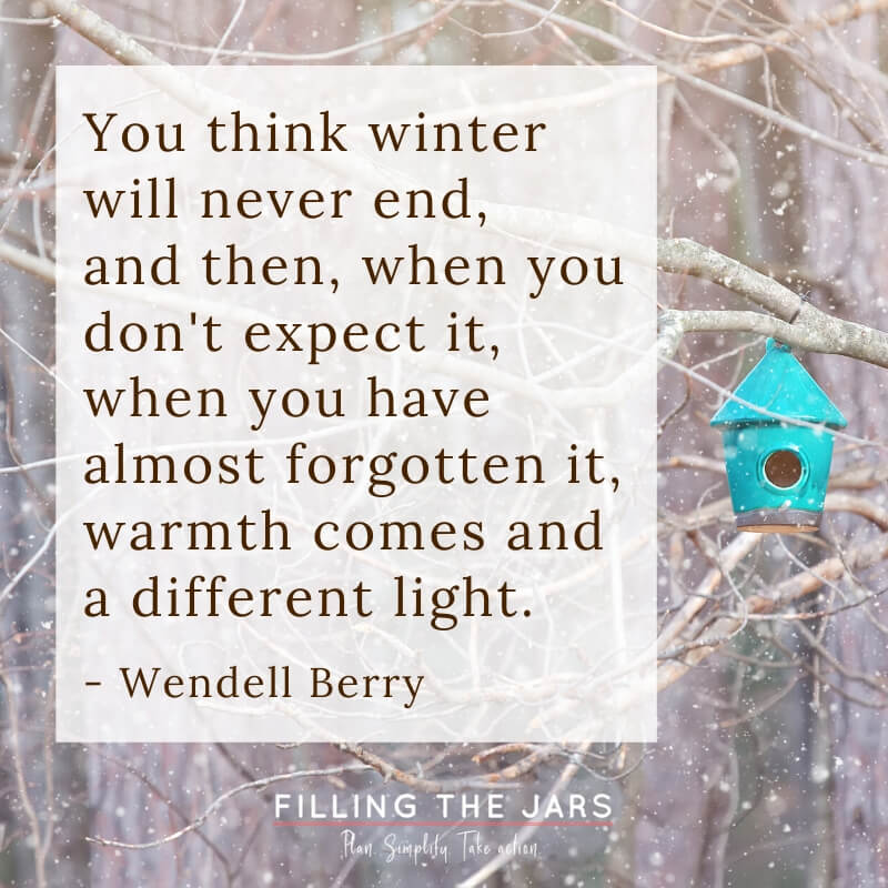 wendell berry you think winter will never end quote on background with trees and falling snow and tuquoise birdhouse
