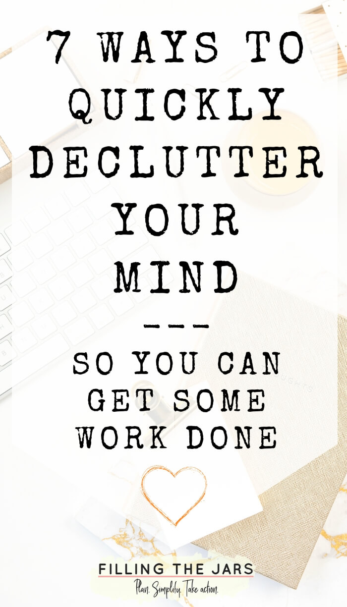 white desktop with office items and text overlay ways to quickly declutter your mind