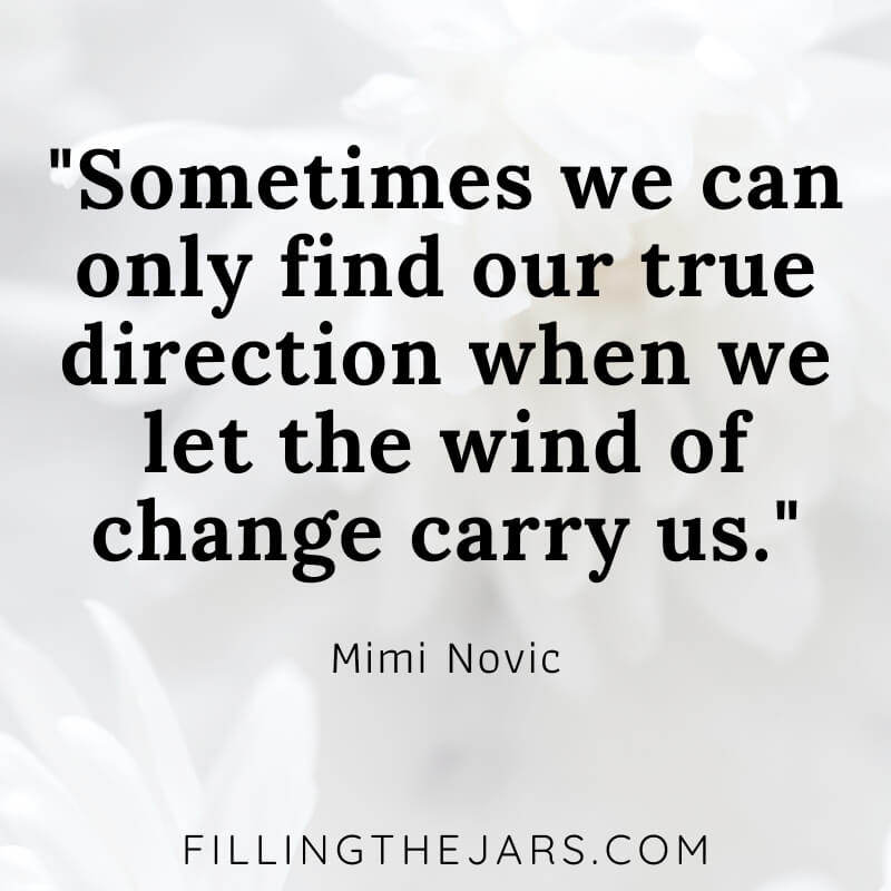 mimi novic wind of change quote on white flower background