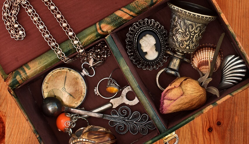 memory box of sentimental items on wood background