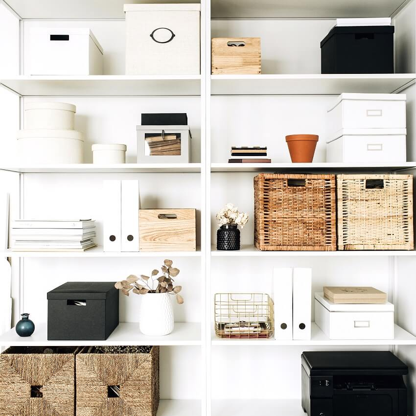 white shelves with various organized storage containers