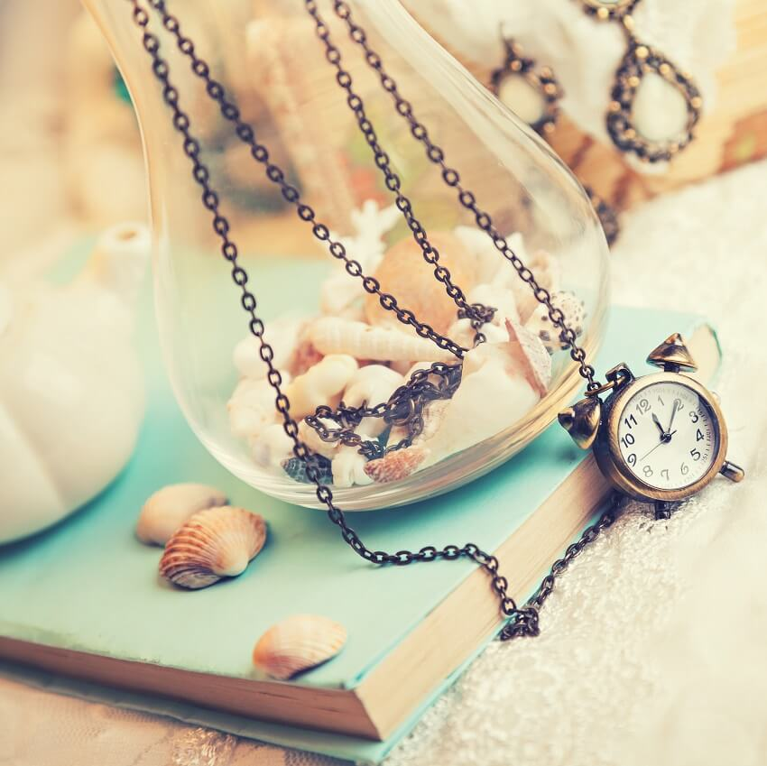 sentimental book, shells, jewelry on white background