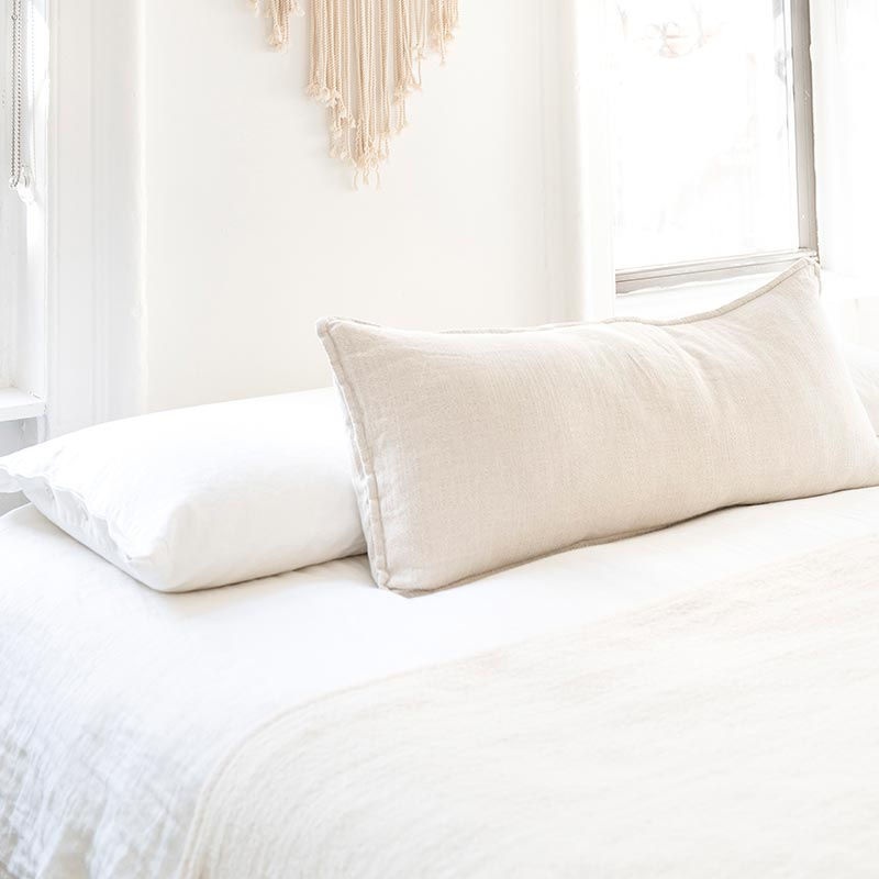 minimalist white bedroom with white bedding and white walls