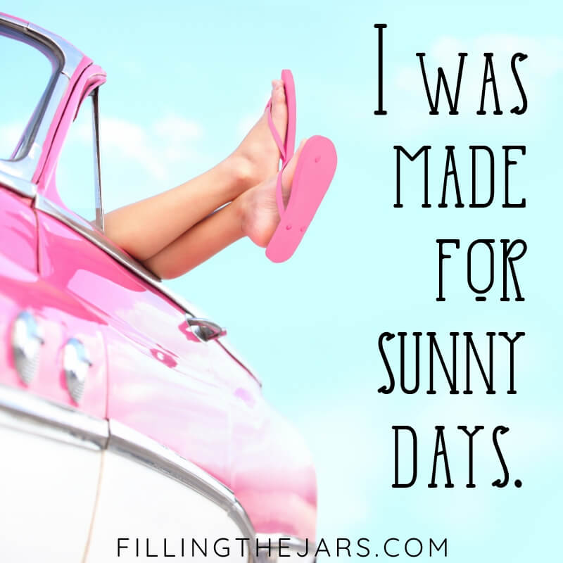 summer sky background with vintage pink car and female legs hanging out with text overlay i was made for sunny days
