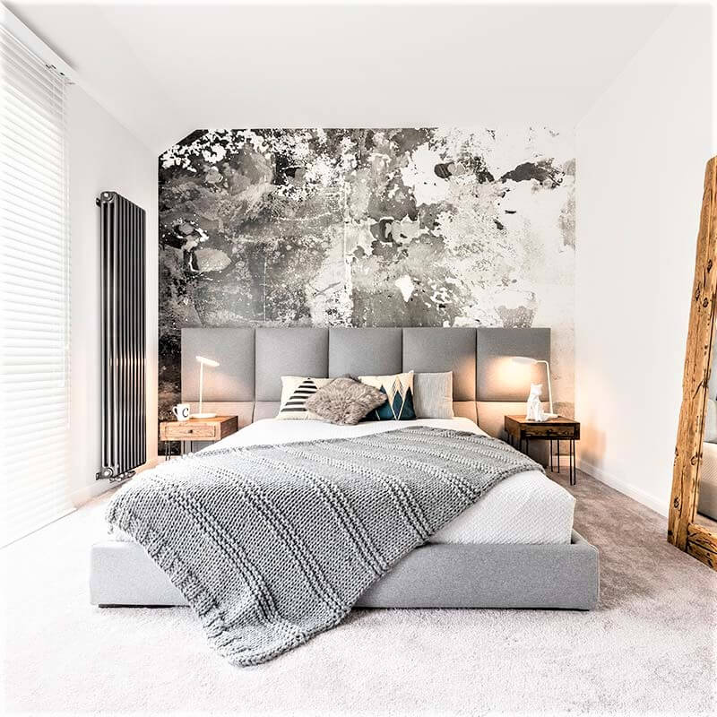 minimalist bedroom with gray and wood accents