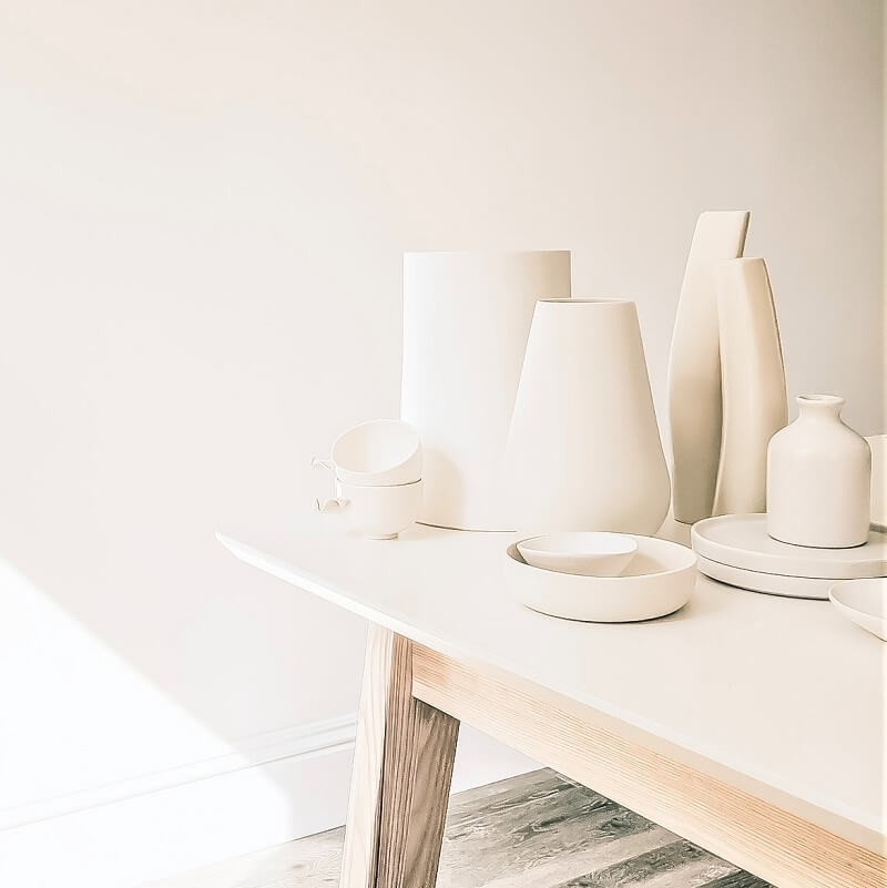 white pottery on white table in white sunlit room