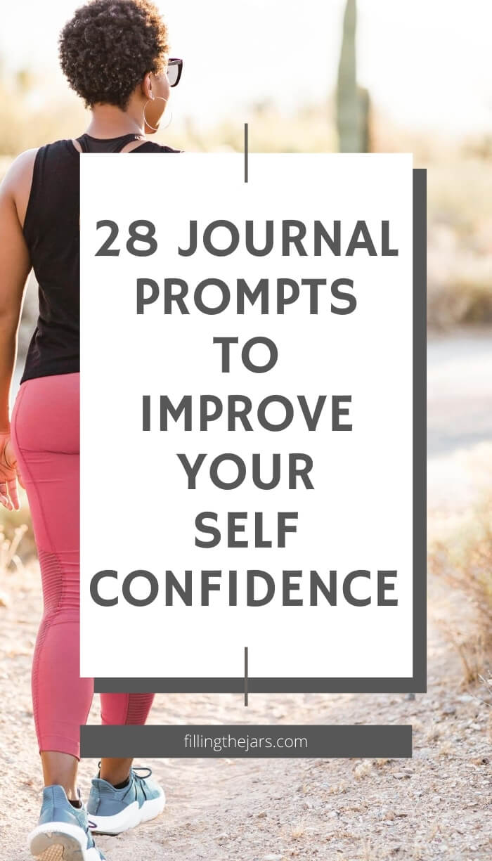 woman in black athletic top and pink leggings walking away through desert with white overlay and text journal prompts to improve confidence
