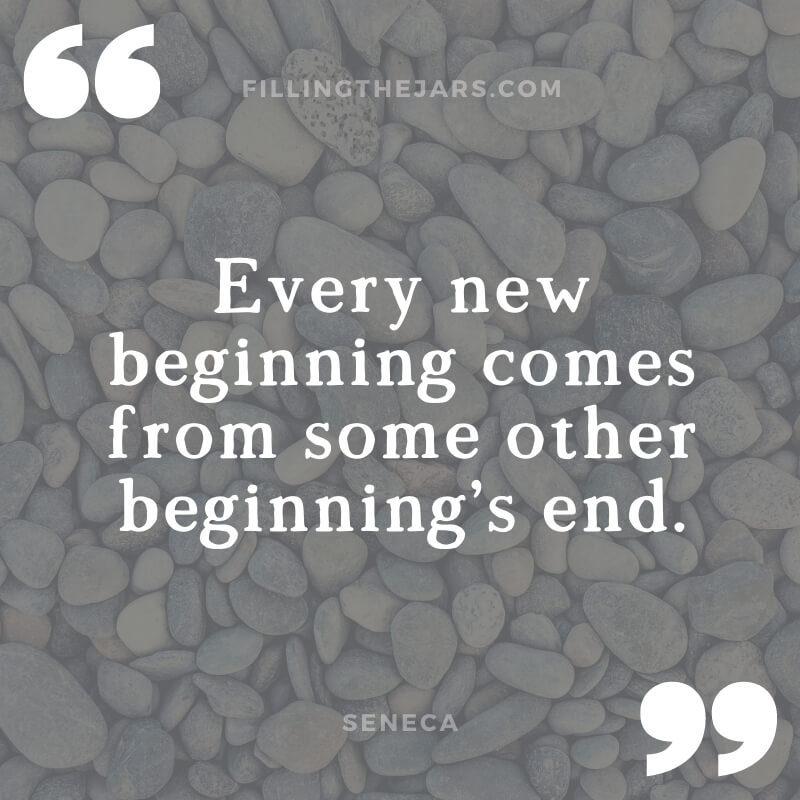 Seneca quote every new beginning in white text on dark background over image of beach pebbles