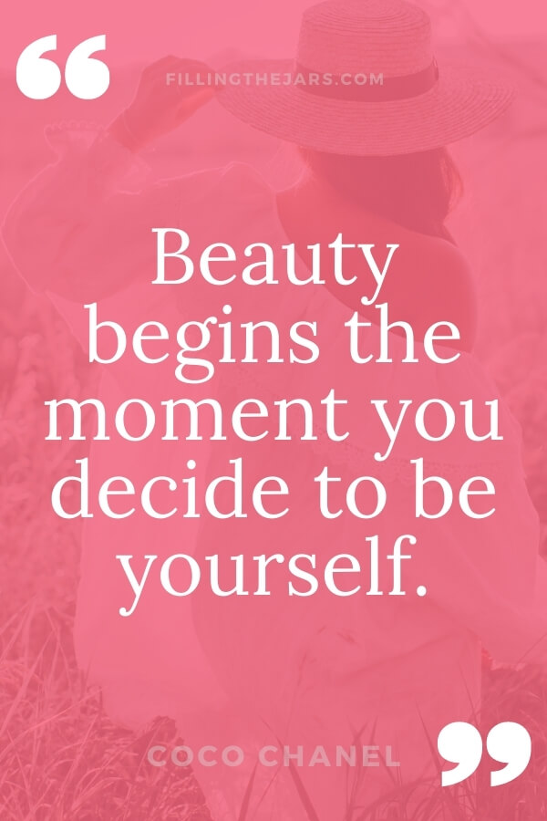 Coco Chanel beauty begins quote in white text on dark pink background over image of woman in white dress and hat standing in grass
