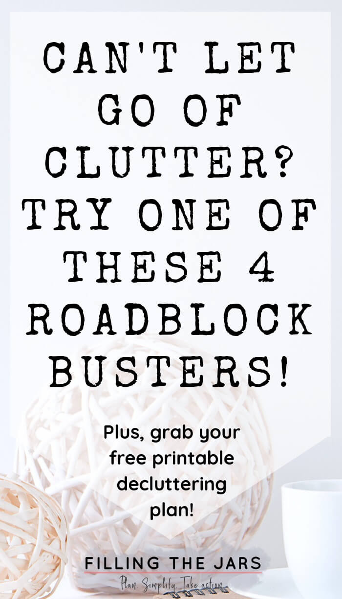 text roadblock busters to let go of clutter on white background over image of rustic white vine balls and white teacup