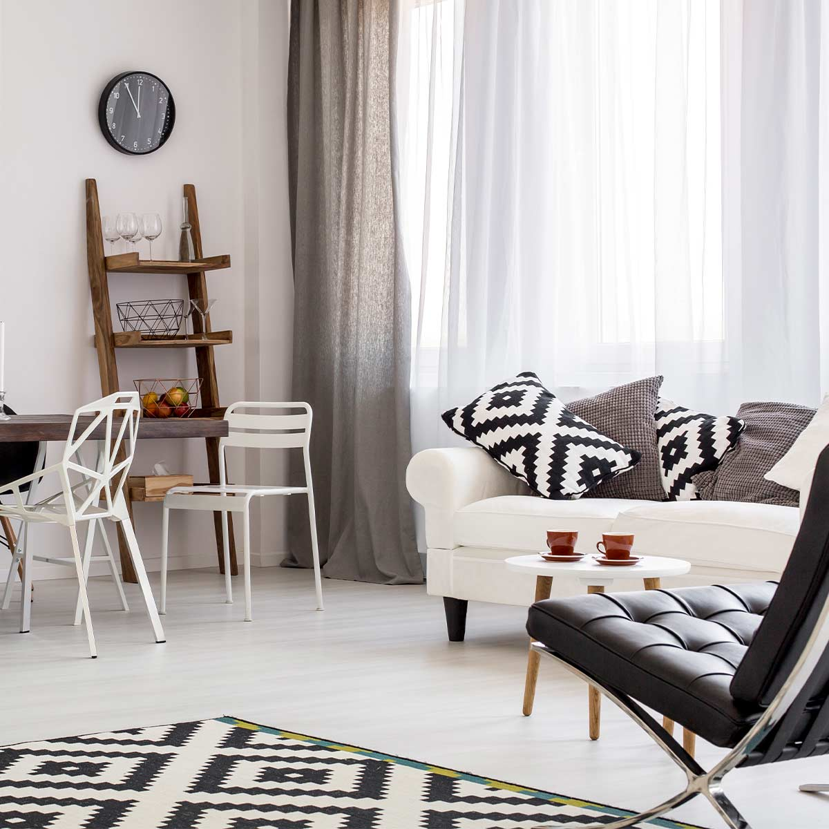 beautiful clutter-free room in neutral shades of black and white and gray with wood accents
