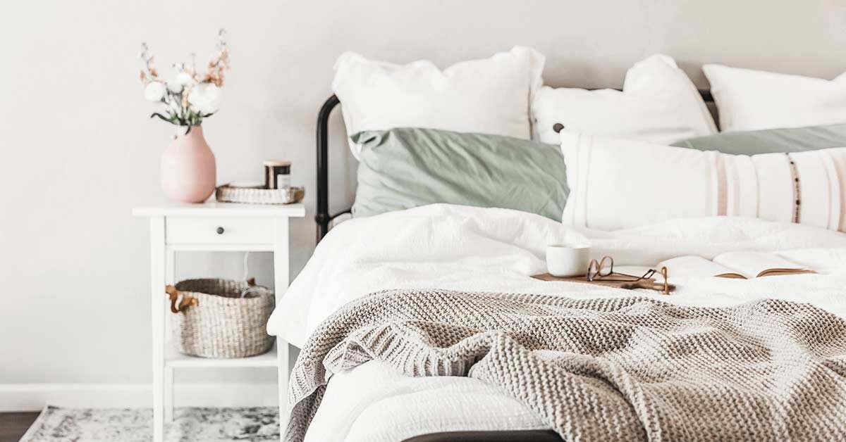 welcoming and simple clutter-free white bedroom