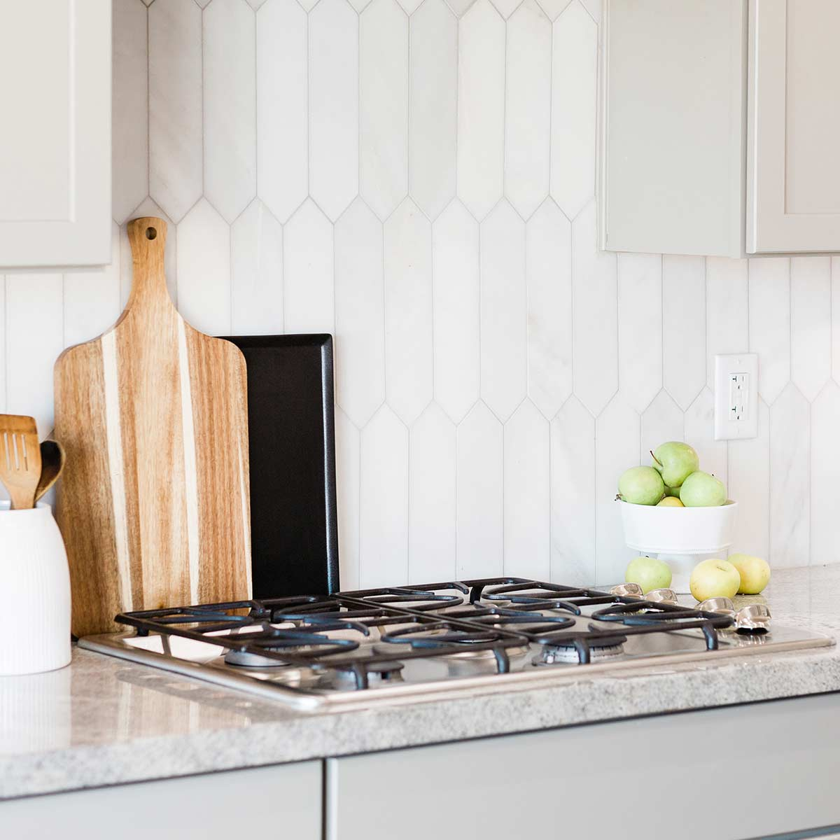 simple and clutter-free kitchen counter with white tile backsplash