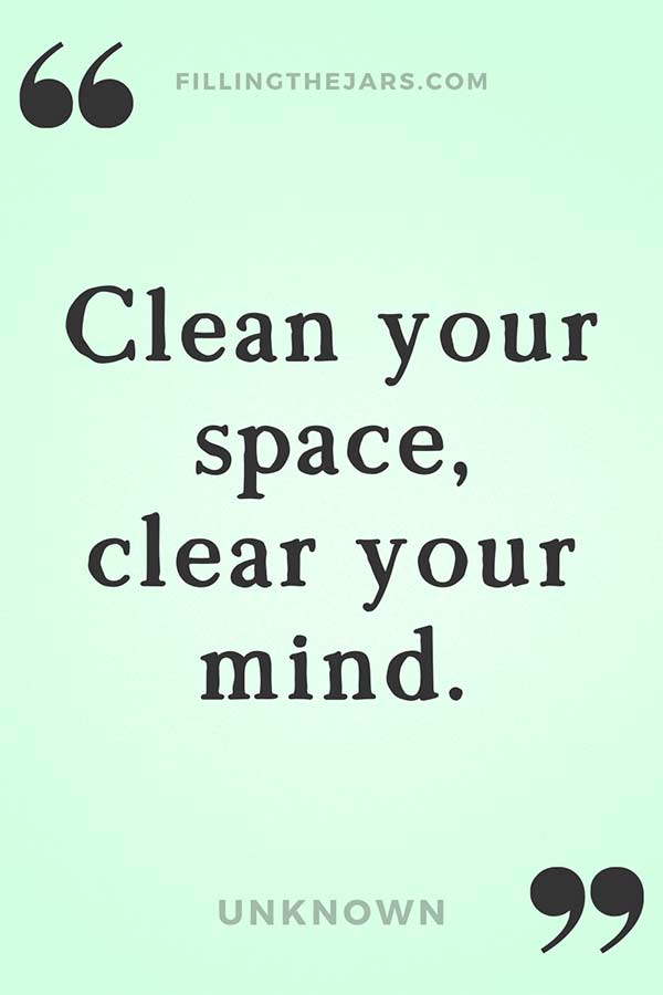 Clean your space clear your mind quote in black text on pale green background.