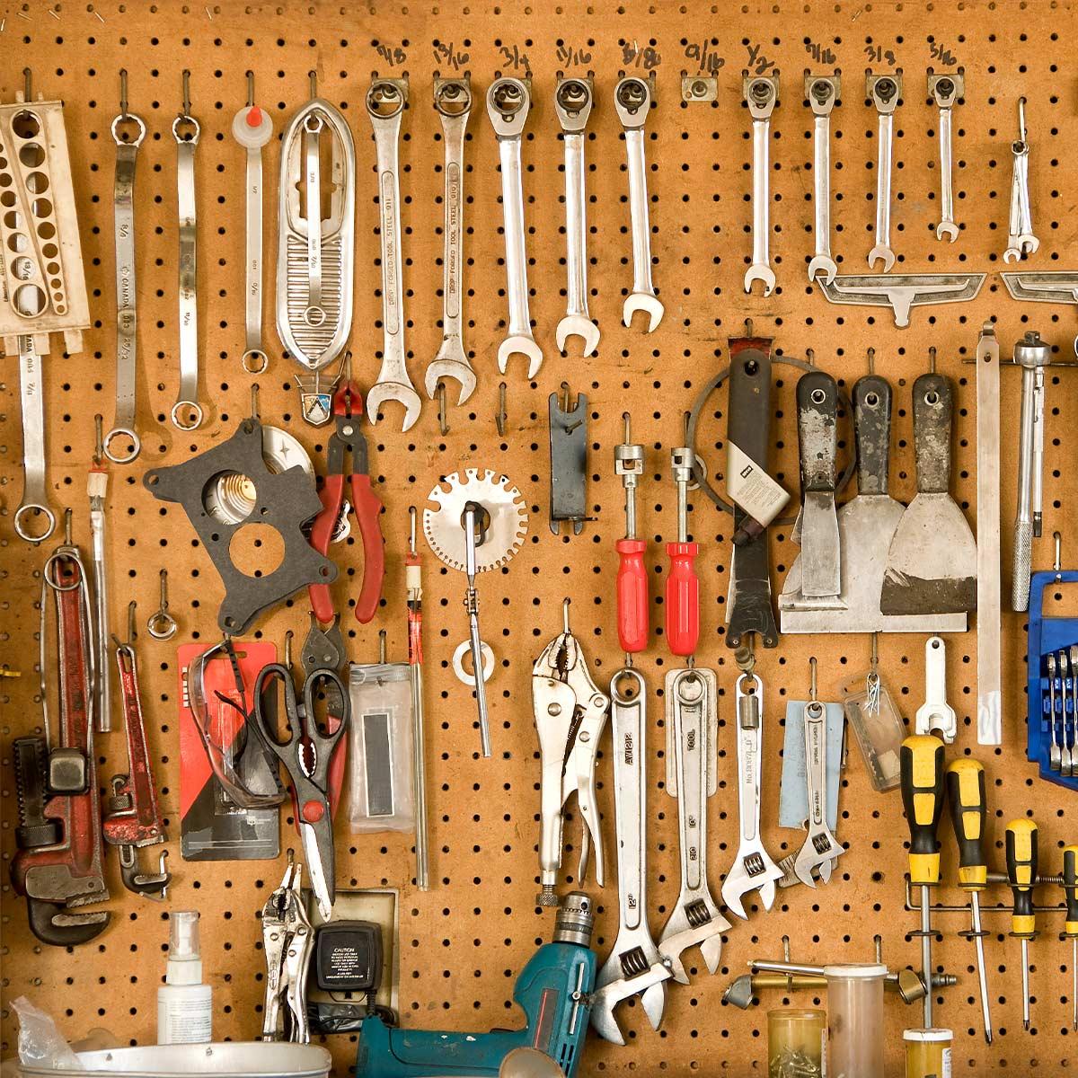 Organized garage tools on pegboard.
