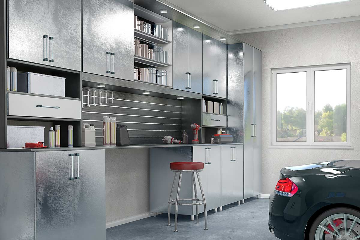 Very clean and organized garage with metal cabinets.