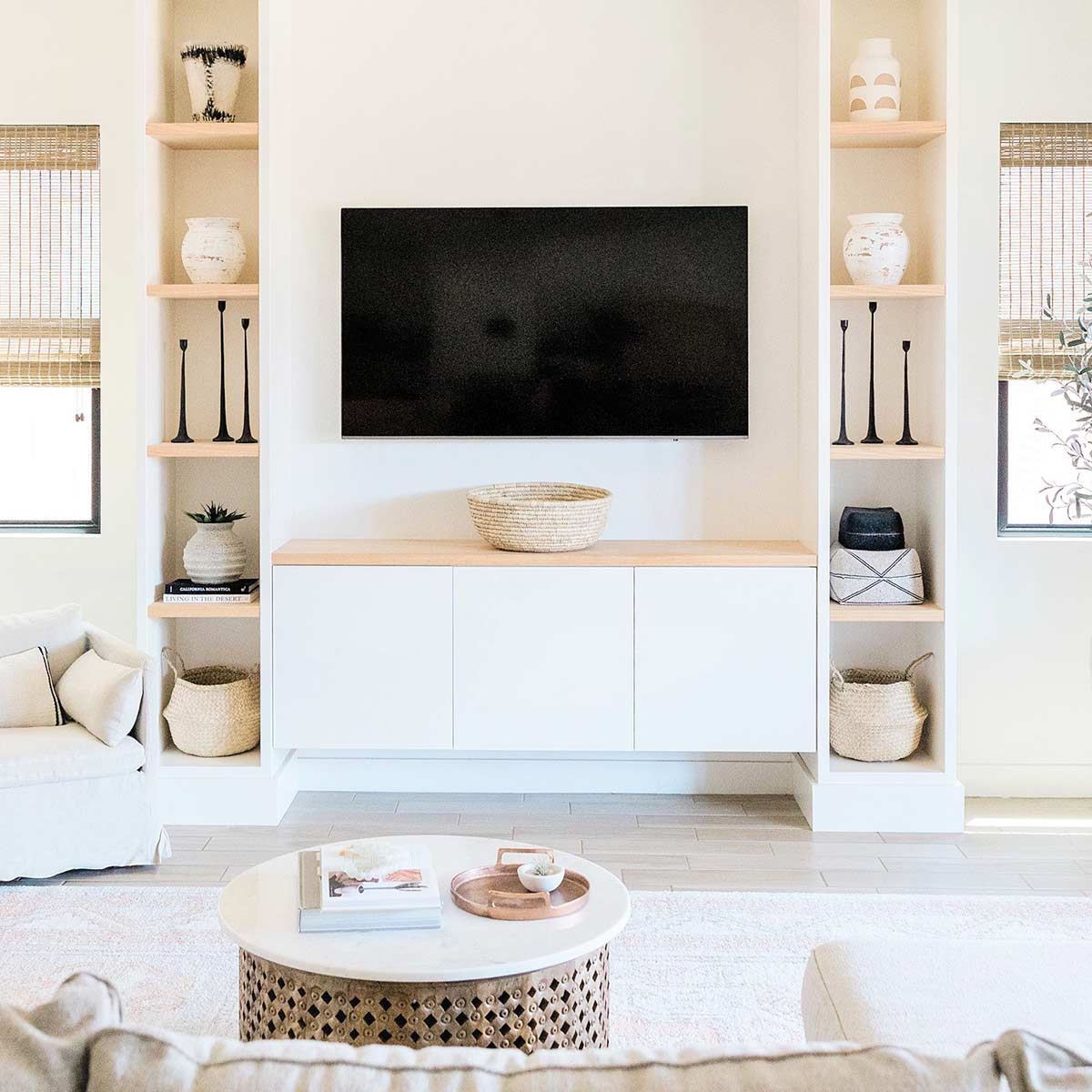 Living room with white and neutral decor looks amazing after weekend decluttering.