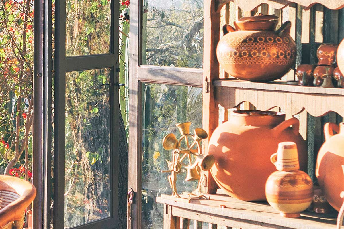 Sunny room with wooden shelf full of decorative pieces that are hard to declutter.