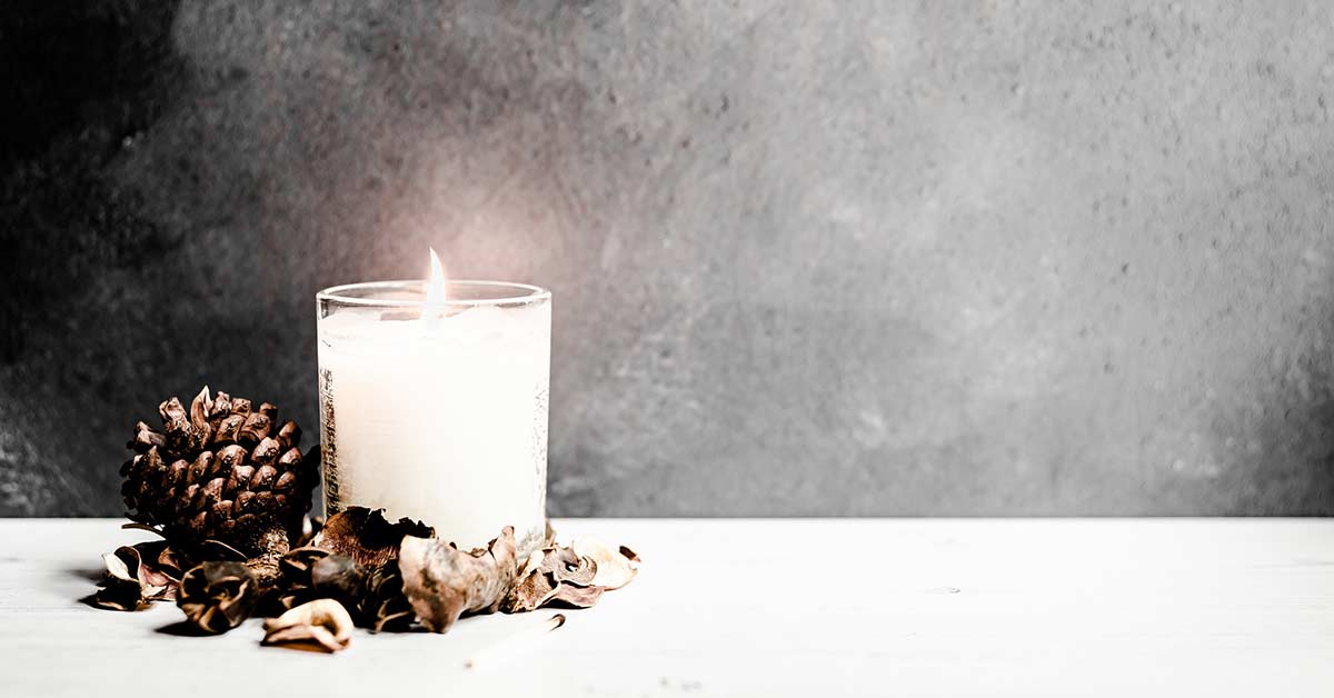 Featured moody image with candle for October creative writing prompts.